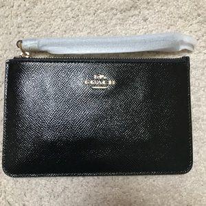 Coach black patent leather wristlet